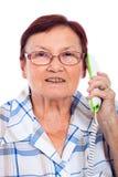 Mujer mayor feliz en el teléfono Fotografía de archivo libre de regalías