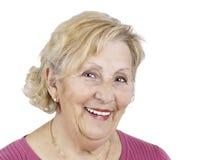 Mujer mayor feliz sobre blanco Imagen de archivo libre de regalías