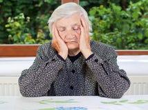 Mujer mayor infeliz Fotos de archivo libres de regalías