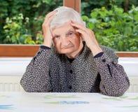 Mujer mayor infeliz Fotografía de archivo