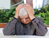 Mujer mayor infeliz Imagen de archivo libre de regalías