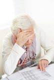 Mujer mayor infeliz que mira Fotos de archivo libres de regalías