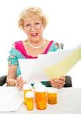 Alto coste de medicamentos de venta con receta y de asistencia médica Fotografía de archivo libre de regalías