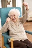 Mujer mayor que celebra Fotos de archivo libres de regalías