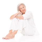 Mujer mayor que se sienta Imagen de archivo