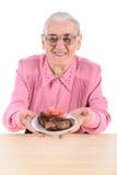 Mujer mayor que sostiene la carne Fotografía de archivo libre de regalías