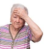 Mujer mayor que sufre de dolor de cabeza Imagenes de archivo