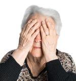 Mujer mayor que sufre de dolor de cabeza Imagen de archivo