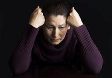 Mujer mayor triste Fotos de archivo