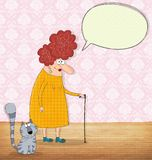 Mujer mayor y gato que conversan Imagenes de archivo
