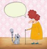 Mujer mayor y gato que conversan Foto de archivo
