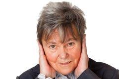 Mujer mayor y ruido Imagenes de archivo