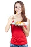 Mujer morena hermosa que come el sushi Fotografía de archivo