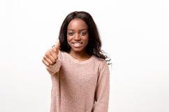 Mujer motivada entusiasta que da un pulgar para arriba Fotografía de archivo