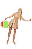 Mujer muchos panieres después de hacer compras Imagen de archivo