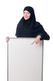Mujer musulmán con el tablero en blanco Imagenes de archivo