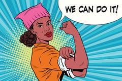 Mujer negra del activista político podemos hacerlo Sombrero rosado del gato del gatito Foto de archivo