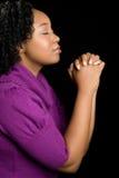 Mujer negra que ruega Imagen de archivo libre de regalías