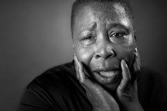 Mujer negra que se aflige Imagenes de archivo