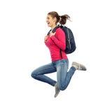 Mujer o estudiante feliz con el salto de la mochila Imagen de archivo