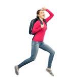 Mujer o estudiante feliz con el salto de la mochila Imagen de archivo libre de regalías