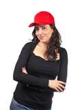 Mujer ocasional con un casquillo rojo Imágenes de archivo libres de regalías