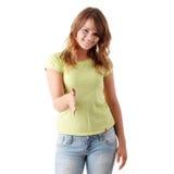 Mujer ocasional joven con una mano abierta Imagenes de archivo