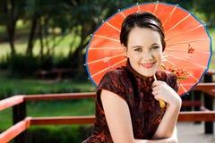 Mujer occidental en cultura china Imágenes de archivo libres de regalías