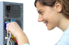 Mujer, ordenador, cable, reparación Imagenes de archivo