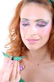 Mujer pelirroja con la mariposa Fotos de archivo