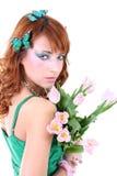 Mujer pelirroja con las flores Imagen de archivo libre de regalías