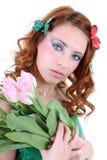 Mujer pelirroja con las flores Imágenes de archivo libres de regalías