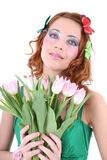 Mujer pelirroja con las flores Fotografía de archivo