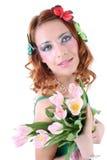 Mujer pelirroja con las flores Foto de archivo libre de regalías