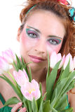 Mujer pelirroja con las flores Fotos de archivo