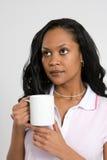 Mujer pensativa con café Imágenes de archivo libres de regalías