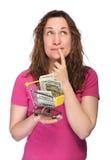 Mujer pensativa con el dinero Fotos de archivo libres de regalías