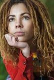 Mujer pensativa con el primer de los dreadlocks Fotos de archivo libres de regalías