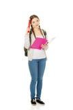 Mujer pensativa del estudiante con el lápiz grande Imagen de archivo