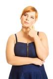 Mujer pensativa del tamaño extra grande Foto de archivo libre de regalías