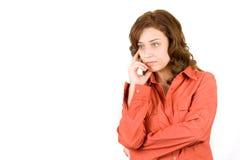 Mujer pensativa en blanco Fotos de archivo libres de regalías