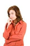 Mujer pensativa en blanco Imagen de archivo libre de regalías