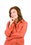 Mujer pensativa en blanco Imagen de archivo