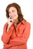 Mujer pensativa en blanco Foto de archivo libre de regalías