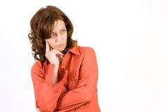 Mujer pensativa en blanco Imágenes de archivo libres de regalías