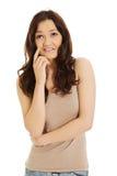 Mujer pensativa joven feliz Imagen de archivo libre de regalías
