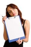 Mujer pensativa que lleva a cabo un espacio en blanco imágenes de archivo libres de regalías