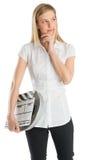 Mujer pensativa que sostiene la pizarra y el carrete de la película mientras que mira lejos Fotografía de archivo libre de regalías