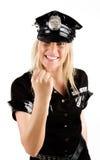 Mujer policía que muestra a Foto de archivo