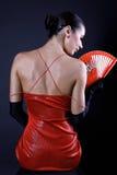 Mujer posterior del latino con el ventilador rojo Imágenes de archivo libres de regalías